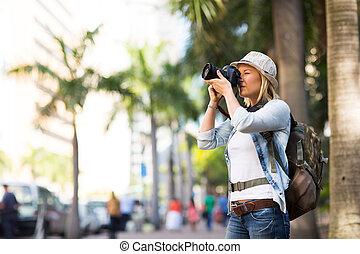 tourist taking photos in the urban city