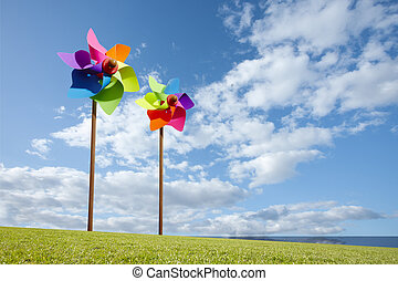 Toy windmill concept of green energy wind farm by the sea