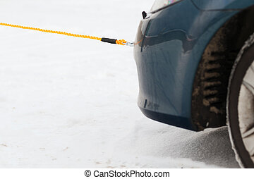 closeup of towed car with towing rope