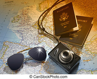 Two US American passports, camera and sunglasses over map of Europe
