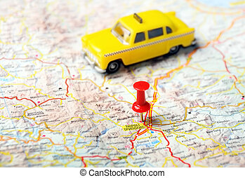 Close up of Tripoli ,Greece map with red pin and a taxi - Travel concept