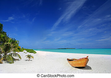 Tropical Maldivian beach with palms and wooden fising ship