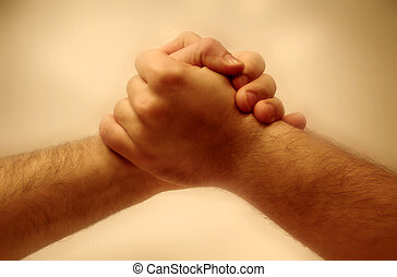 Two hands grabbing each other.