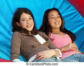 Two happy girl friends