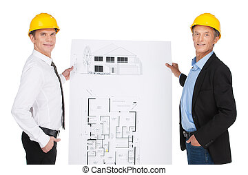 two orlder workers showing plan. site illustration created and developed by engineers