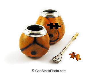 Two yerba mate gourds with missing puzzle element
