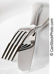 fork and knife on a plate close up shoot