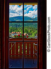 View of amazing mountain landscape in summer through the window