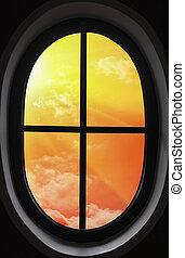 view of the orange sunset through the window