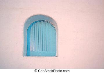 Vintage blue windows on the wall