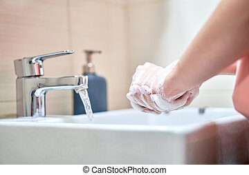Washing of hands with soap under water