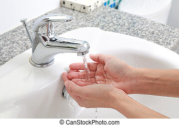 Washing of hands with under running water.