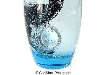Waterproof watch in glass full of water. Service test.