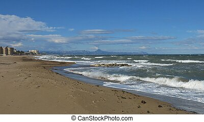 Waves at the beach in Denia, Spain.