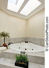 White bath tub with tile stairs. Bathroom in light tones