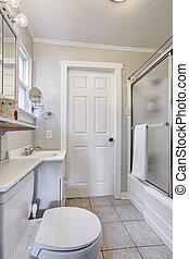 White bathroom with glass door shower