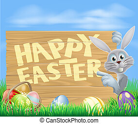White Easter bunny pointing at sign