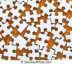 white jigsaw puzzle on wooden background