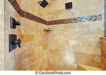 White master bathroom with large walk-in shower.