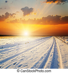 winter landscape. sunset over road with snow