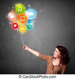 Woman holding social media balloon