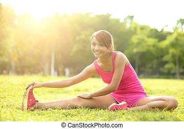 Woman performs stretching