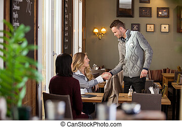Woman Shaking Hands With Male Friend
