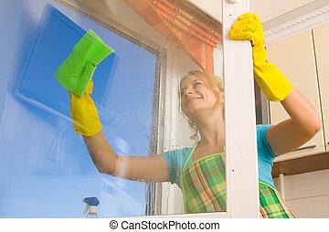 Women cleaning a window 4