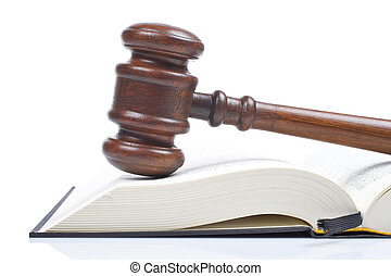 Wooden gavel from the court and law book isolated on white background. Shallow DOF