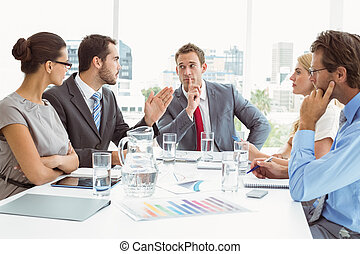 Young business people in board room