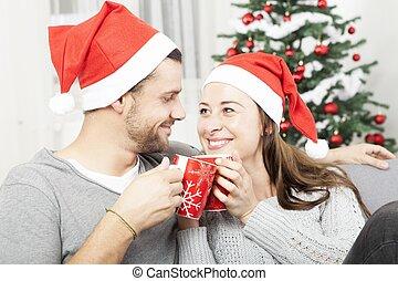 young christmas couple happy on sofa