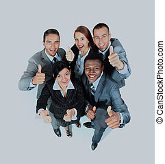Young group of business people showing thumbs up signs in joy.