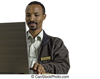 Young happy and diverse man sits at desk using laptop