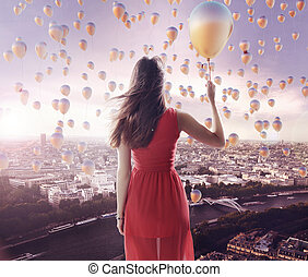 Young lady and the city of the tiny balloons
