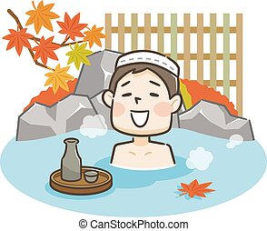 Young man relaxing traditional hot spring onsen bath on vacation
