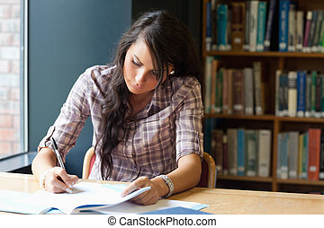 Young student writing