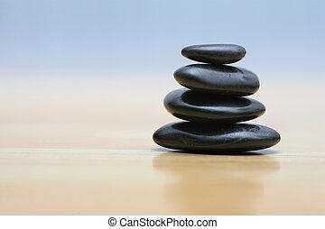 Zen stones on wooden surface
